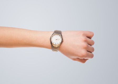 Hand with modern watch showing precise time photo