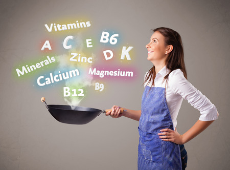 dietetical: Pretty young woman cooking vitamins and minerals