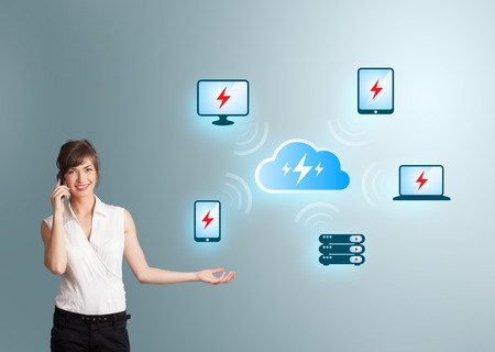 Beautiful young woman making phone call and presenting cloud computing network photo