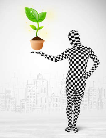 environmental suit: Funny man in full body suit with eco plant, ecological concept Stock Photo