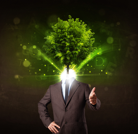 Man with green tree head concept on brown background photo