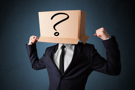 boxy: Businessman standing and gesturing with a cardboard box on his head with question mark