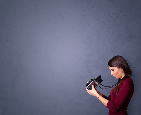 Photographer girl shooting images with copyspace area photo