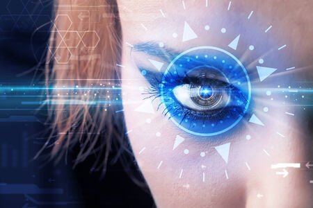 technolgy: Modern cyber girl with technolgy eye looking into blue iris