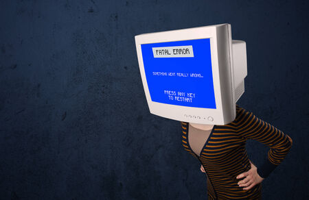 Person with a monitor head and fatal error blue screen on the display photo