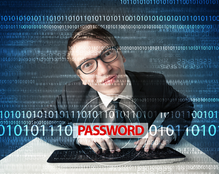 Young geek hacker stealing password on futuristic background photo