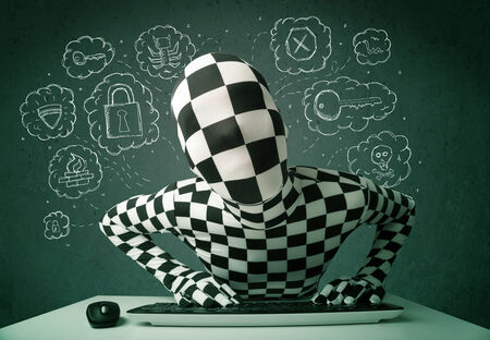 Hacker in mask morphsuit with virus and hacking thoughts on green background photo