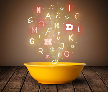 Colorful letters coming out of home cook soup bowl on wood deck Reklamní fotografie