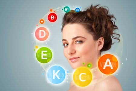 happy young: Pretty young girl with colorful vitamin icons and symbols on gradient background Stock Photo