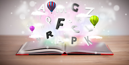 Open book with flying 3d letters on concrete background. Colorful education concept photo