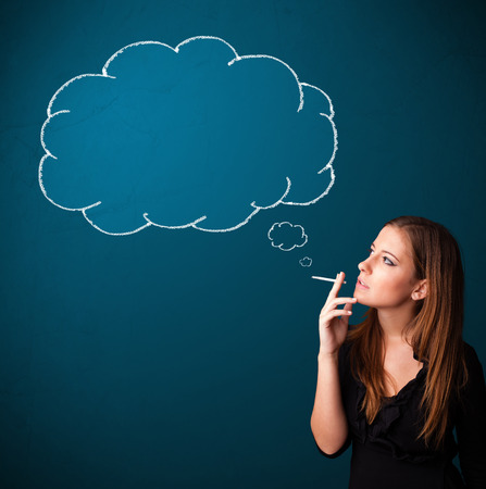 Beautiful young lady smoking cigarette with idea cloud photo