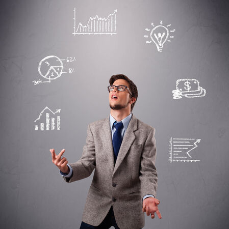 young boy standing and juggling with statistics and graphs Stock Photo