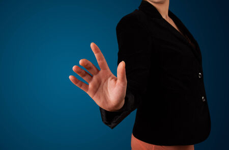 Young woman pressing imaginary button photo