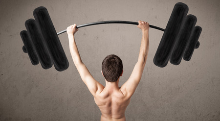 Funny skinny guy lifting incredible weights Stock Photo