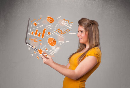 Beautiful young lady holding laptop with graphs and statistics Stock Photo