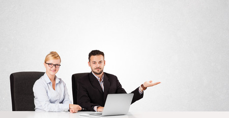 Young businessman and businesswoman with plain white copy space photo