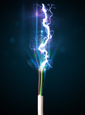 Electric cable close-up with glowing electricity lightning photo
