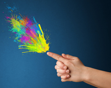 shaped hands: Colored splashes are coming out of gun shaped hands