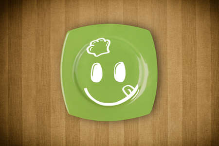 breakfast smiley face: Happy smiley cartoon face on colorful dish plate and grungy background