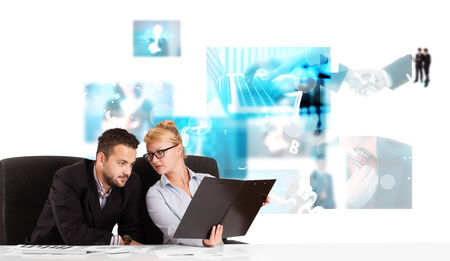 Business persons at desk with modern blue tech images at background photo