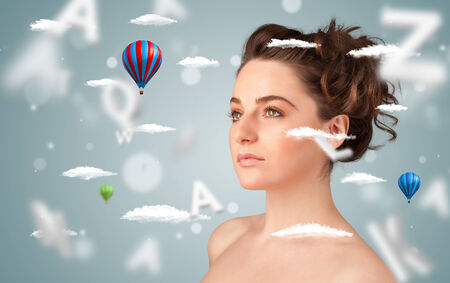 Beautiful young woman with wellness and healthcare clouds on gradient background photo