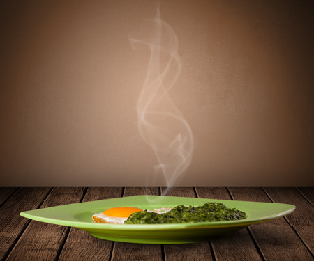 home cooked: Fresh delicious home cooked food with steam on wood deck Stock Photo