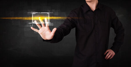 Tech person touching button with orange light beams concept  photo