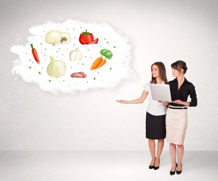 Young girl presenting nutritional cloud with vegetables concept photo
