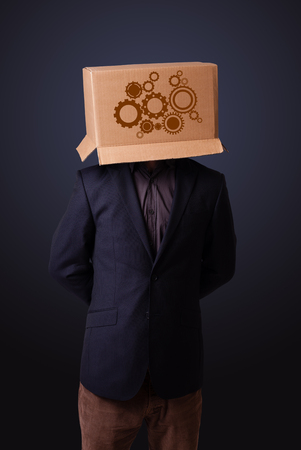 boxy: Young man standing and gesturing with a cardboard box on his head with spur wheels