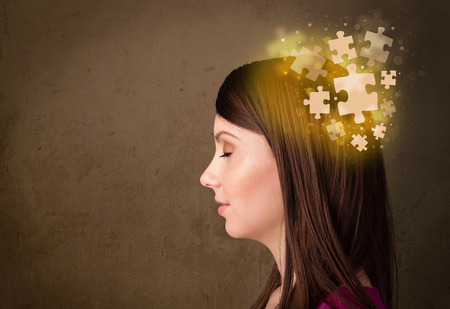 person thinking: Young person thinking with glowing puzzle mind on grungy background