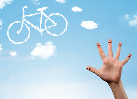 Happy cheerful smiley fingers looking at a bicycle shapeed cloud photo