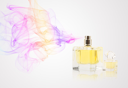 perfume spray: Perfume bottle spraying colorful scent