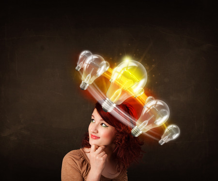 Preety woman with light bulbs circleing around her head  photo