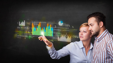 Business couple touching colorful charts and diagrams  photo