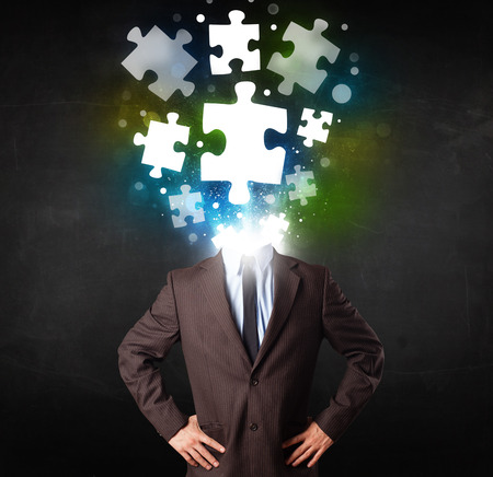 mental confusion: Character in suit with glowing puzzle head concept