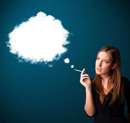 unhealthy: Pretty young woman smoking unhealthy cigarette with dense smoke