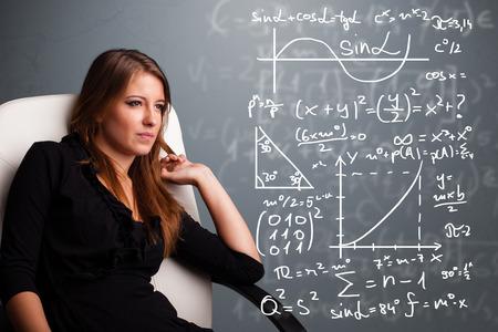 signos matematicos: Hermosa joven de la escuela piensa la chica acerca de los signos matem�ticos complejos