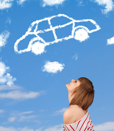Casual young girl looking at car cloud on a blue sky photo