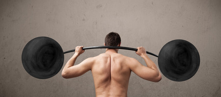 Funny skinny guy lifting incredible weights photo