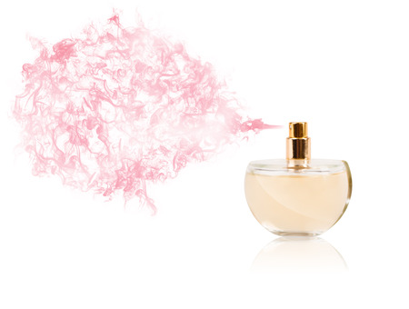 photomanipulation: Perfume bottle spraying colorful scent