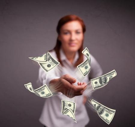Beautiful young girl throwing money Stock Photo - 27792623