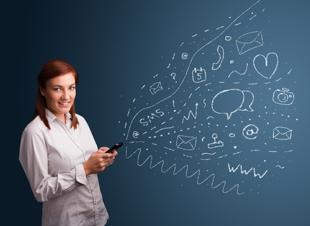 Young girl typing on smartphone with various modern technology icons and symbols photo