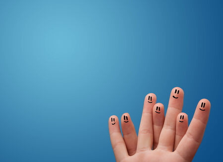 cheerfully: Happy smiley face fingers cheerfully looking at empty blue background copy space