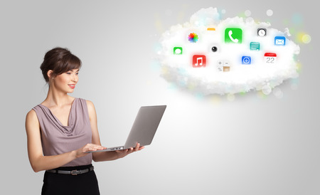 Young woman presenting cloud with colorful app icons and symbols concept photo