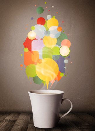 Tea cup with colorful speech bubbles, close up photo