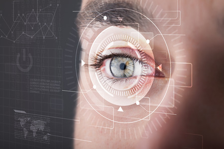 futuristic eye: Modern cyber man with technolgy eye looking