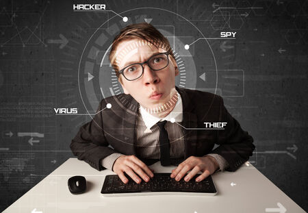 Young hacker in futuristic enviroment hacking personal information on tech background photo