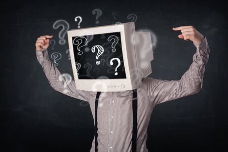 Businessman with a computer monitor head and question marks photo