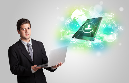 Business man showing modern green tablet technology concept photo