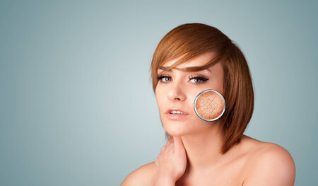 Healthy beautiful young girl with magnifying glass of skin damage photo